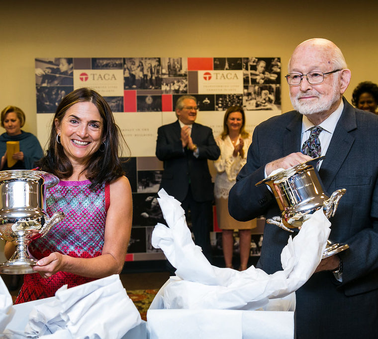 Julie Hersh and Don Stone opening their TACA Silver Cups
