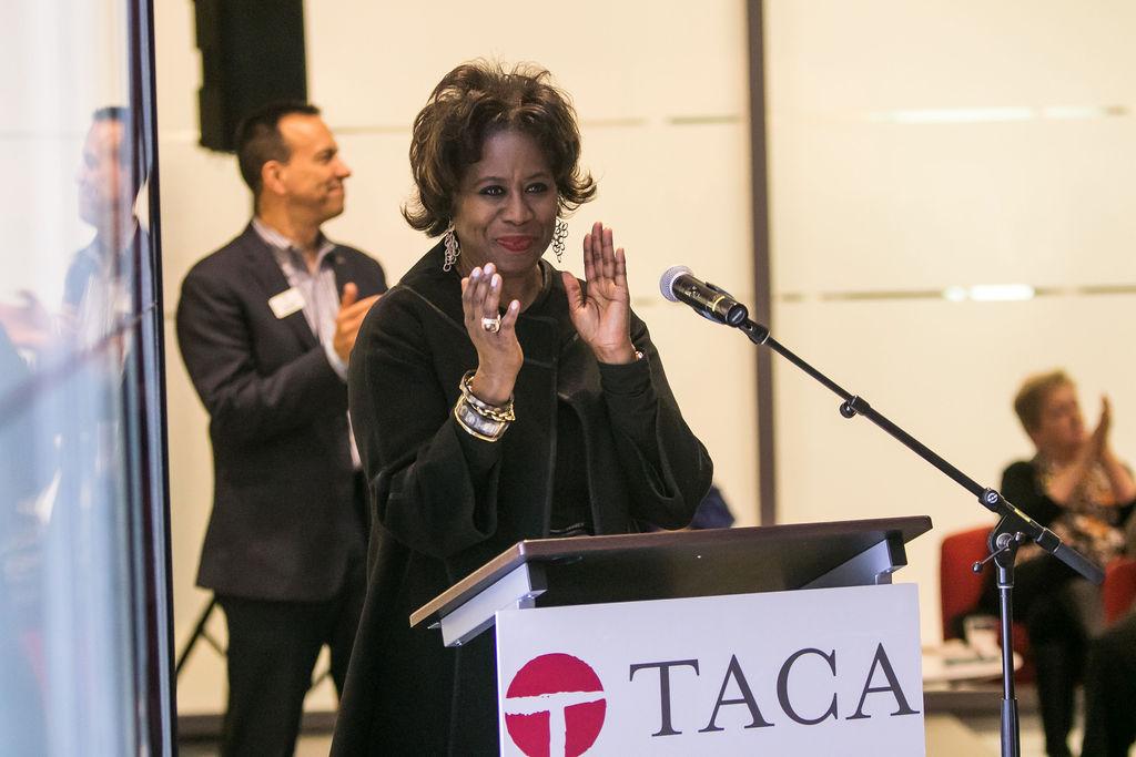 Michelle Thomas applauding TACA's 2019 Grant Recipients