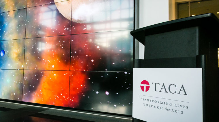 space-themed digital art and TACA podium